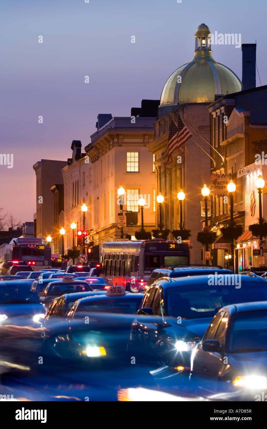 Washington DC, rush hour traffic on M ST & Wisconsin Ave in Georgetown at dusk. - Stock Image
