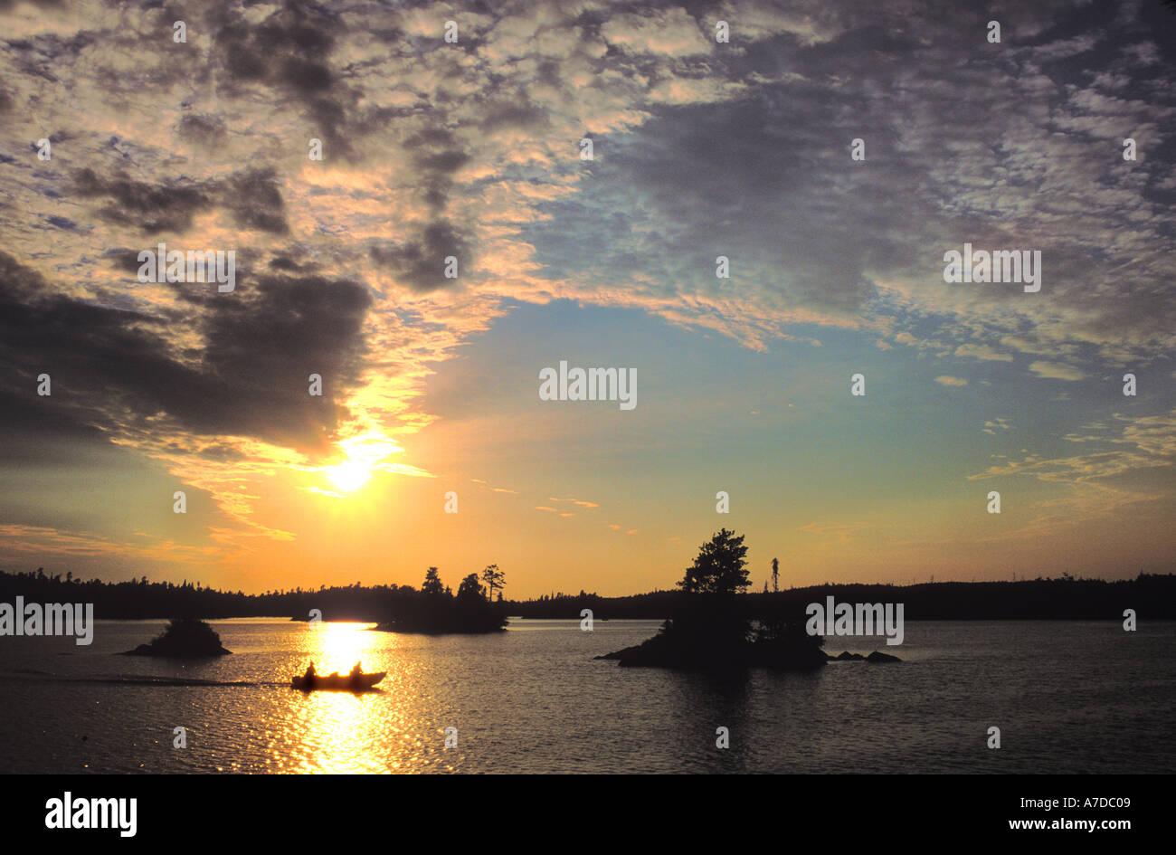 Fishing boat at sunset on Seagull lake Boundary Waters Canoe Area Wilderness Minnesota - Stock Image