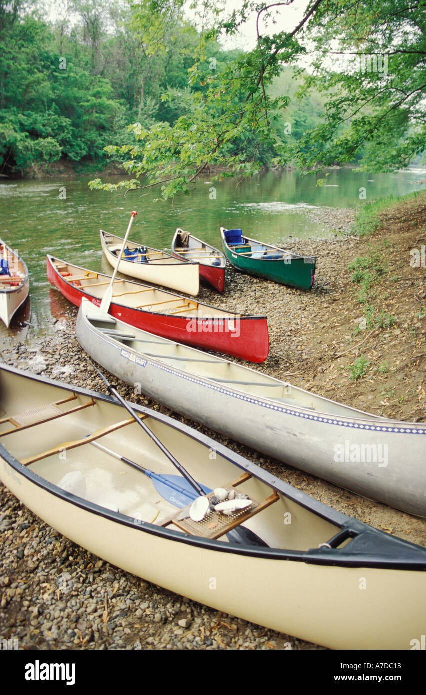 Canoes on the shore of Middle Fork of the Vermilion river a designated national scenic river Kickakpoo State Park Illinois - Stock Image