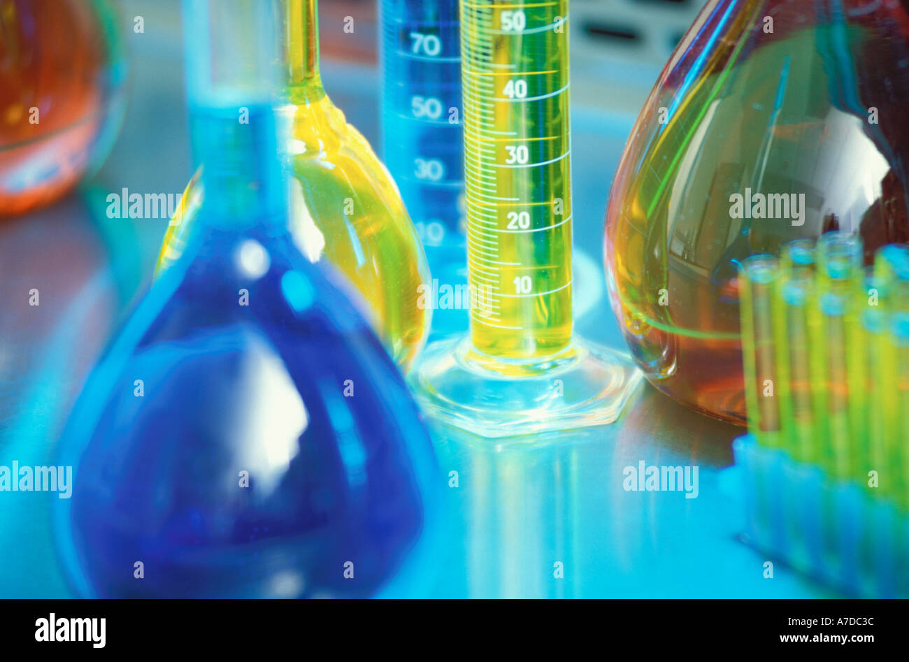 Laboratory flasks tubes and graduated cylinders - Stock Image