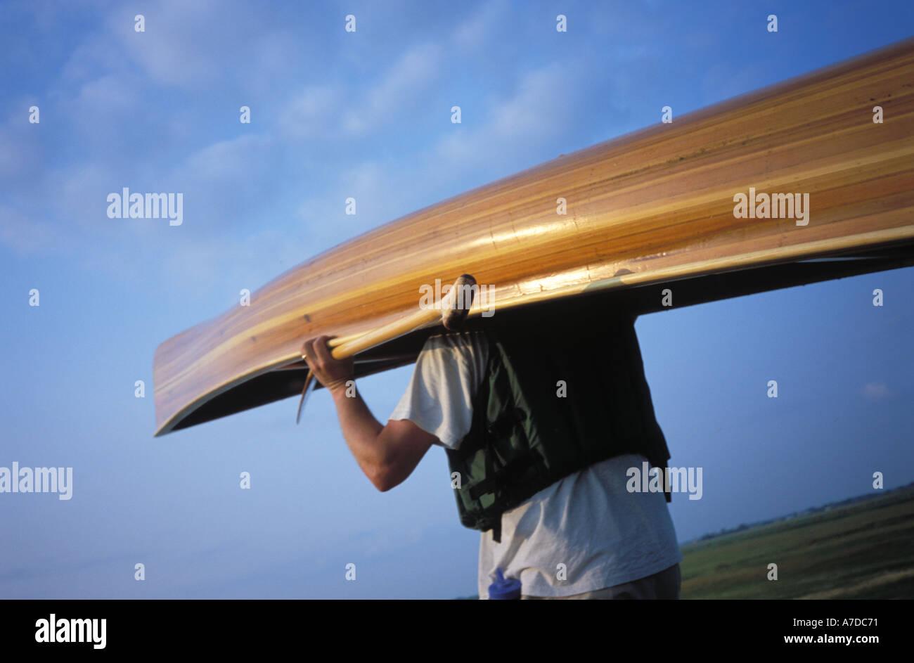 Portaging a canoe in North Dakota MR - Stock Image