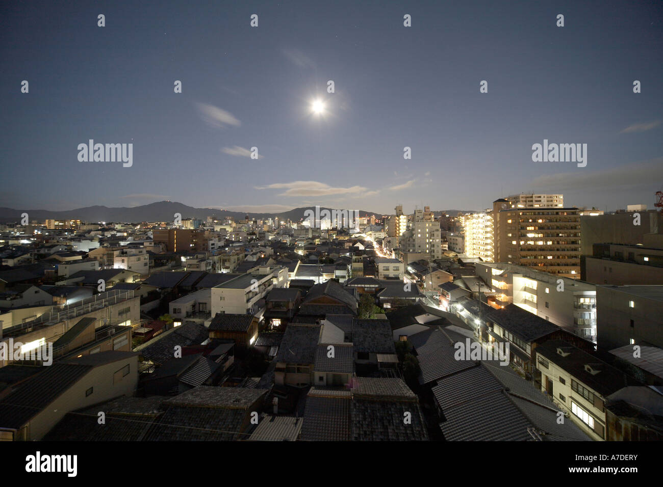 Semi aerial oblique high level view east from Ana Hotel of city of Kyoto at night with full moon Japan Asia - Stock Image