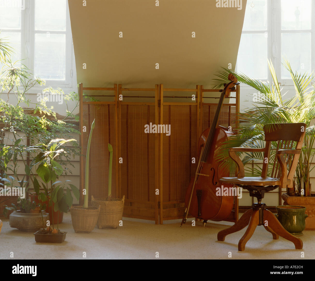 Folding Bamboo Screen And Antique Wooden Captainu0027s Chair In Attic Music  Room With Cello And Houseplants