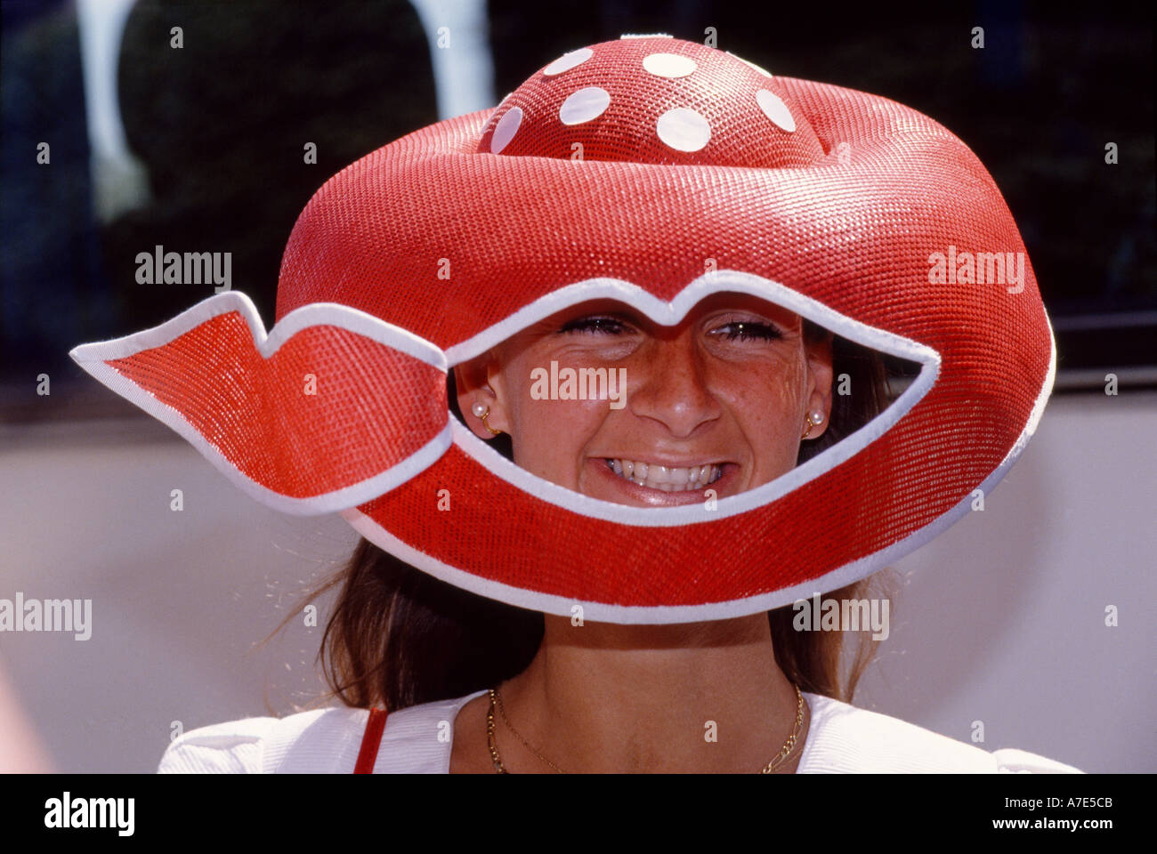 A woman wears a funny hat to Ladies Day at Ascot races in Ascot Berkshire England - Stock Image