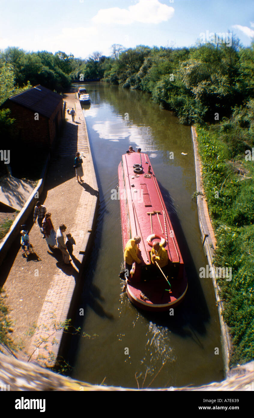 A narrowboat emerges from the Blisworth canal tunnel on the Grand Union Canal in Northamptonshire England UK - Stock Image