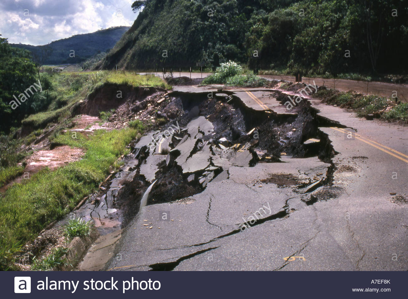 Environmental disaster of road collapsing - Stock Image