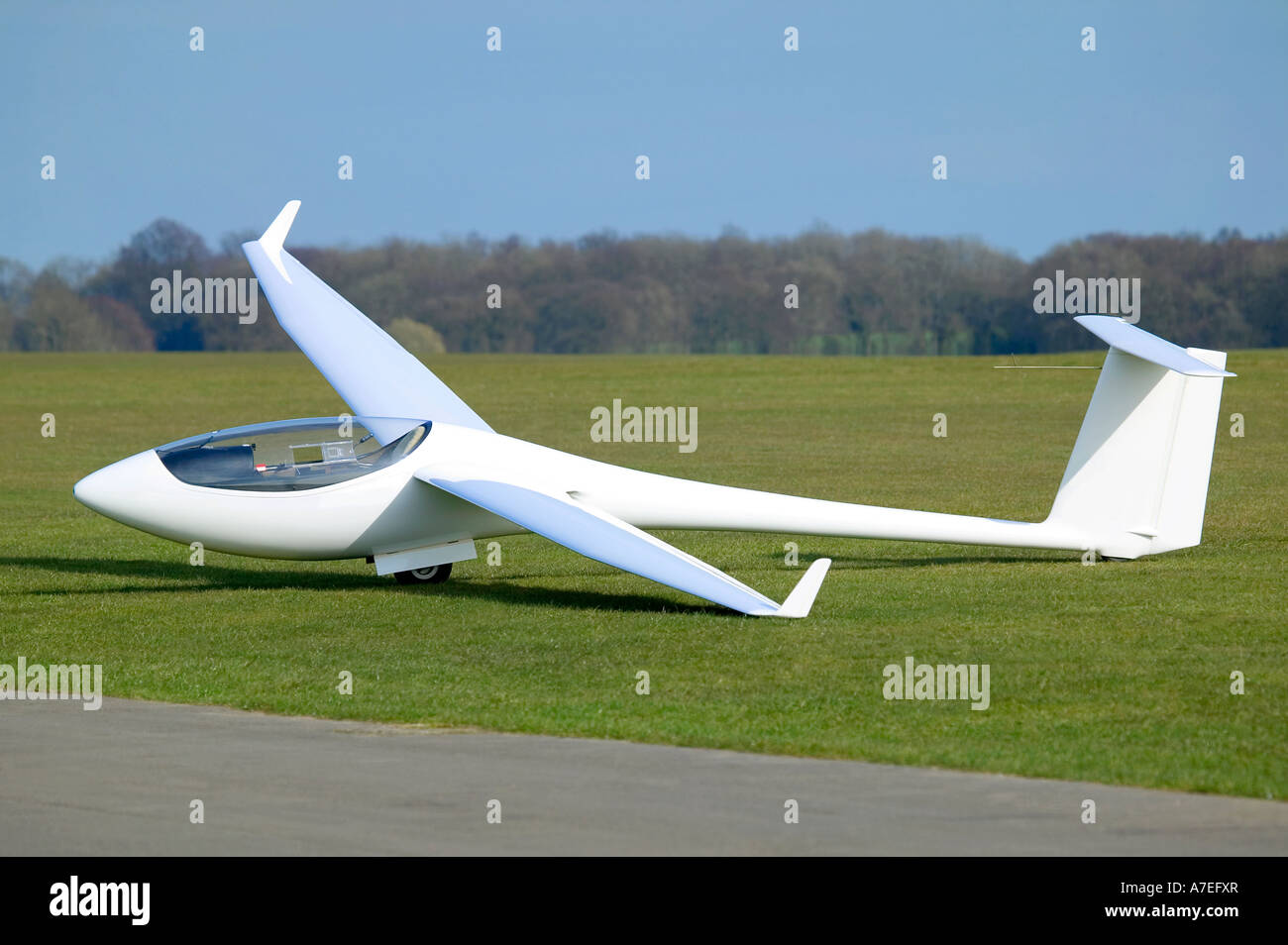 White Plane or Glider at rest on an airfield - Stock Image
