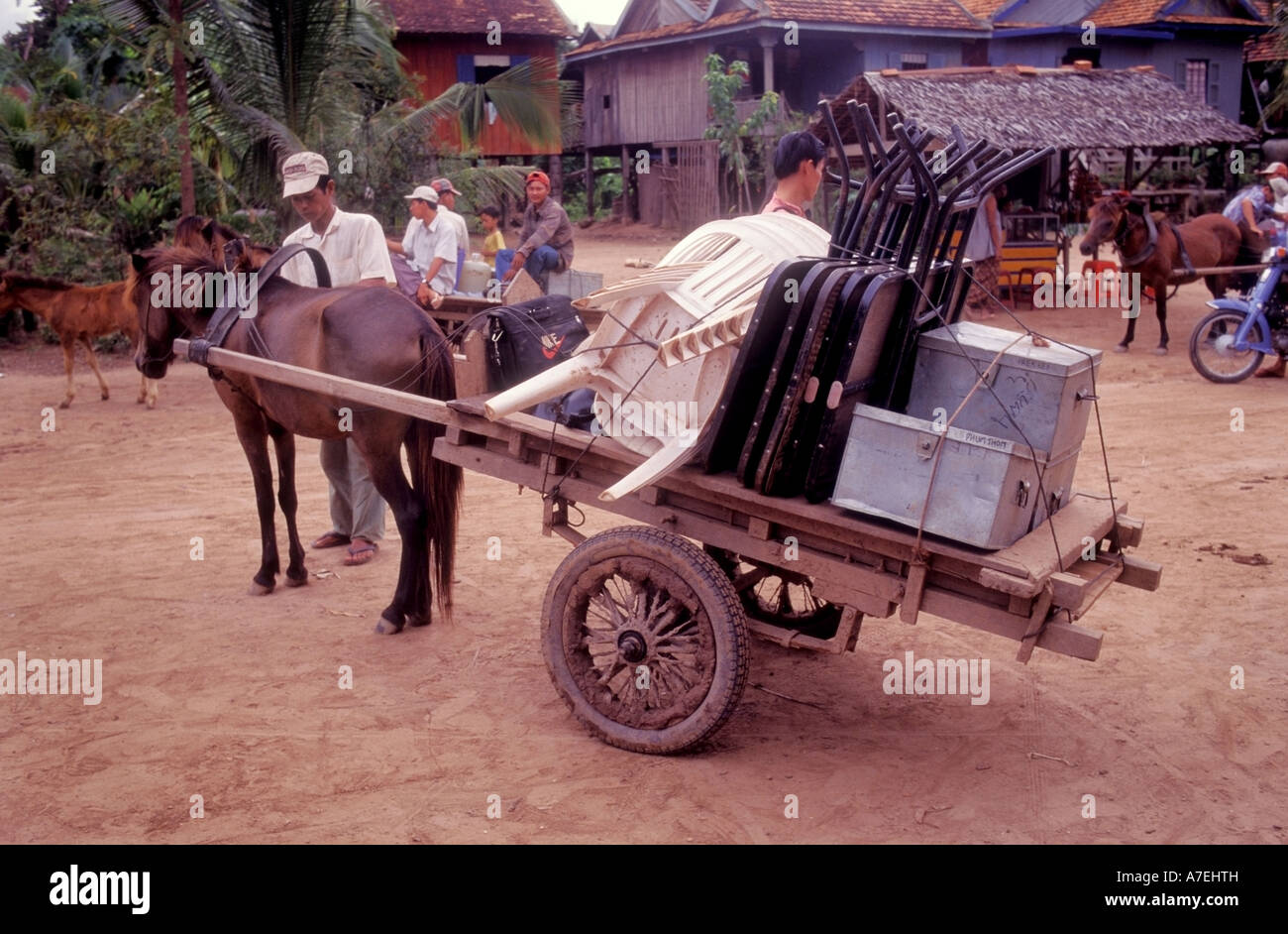 Mobile medical clinic loaded onto horse cart ready to transport to rural Cambodian villages - Stock Image
