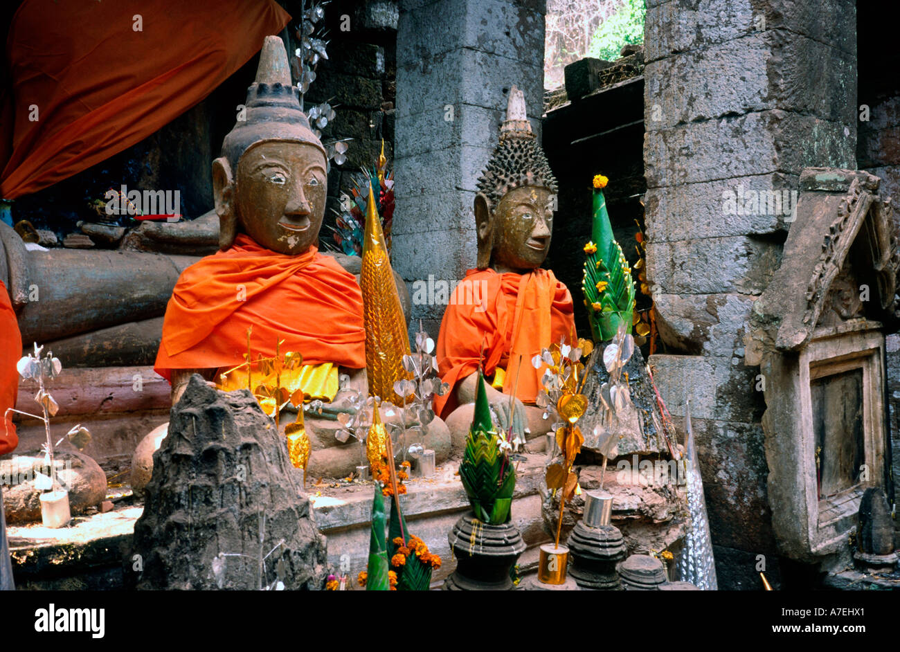 Feb 18, 2003 - Buddhas still dressed up a couple of days after Magha Puja (Full Moon Festival) at Wat Phou in Laos. - Stock Image