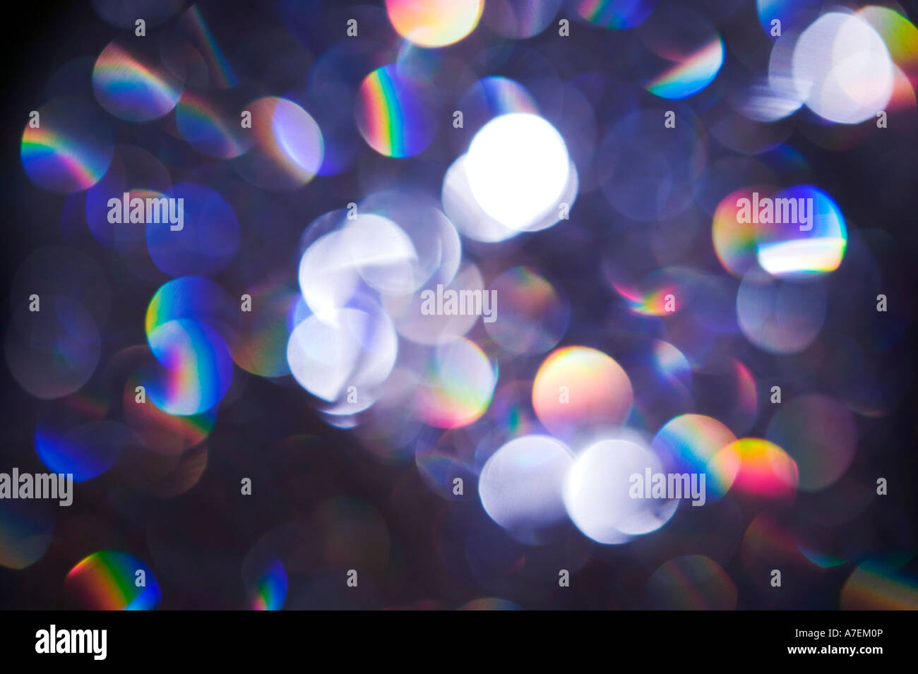 Illuminated sequins with prism light effect - Stock Image
