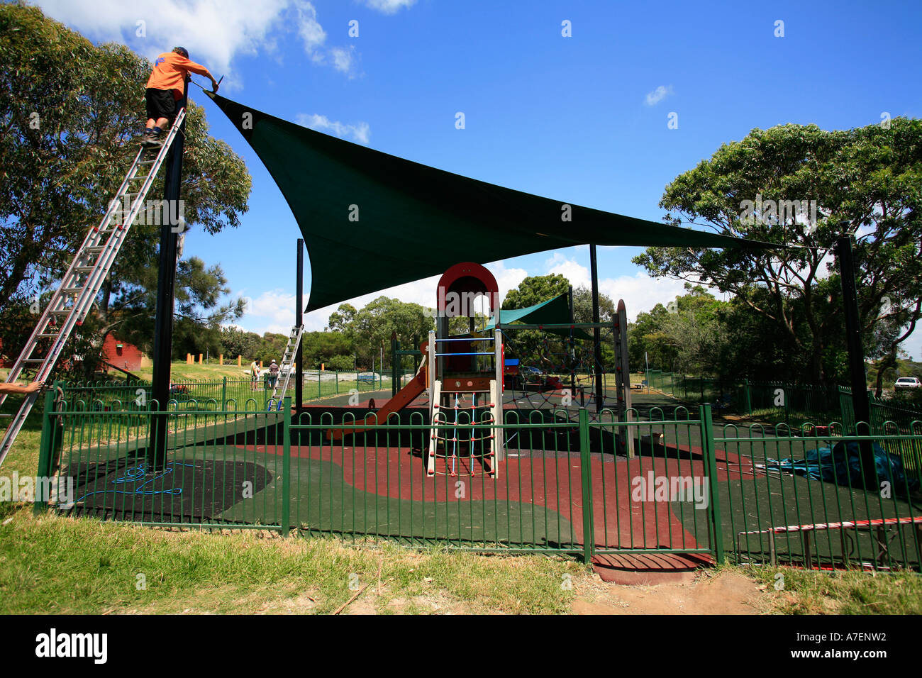Childrens playground with sun protection screen - Stock Image