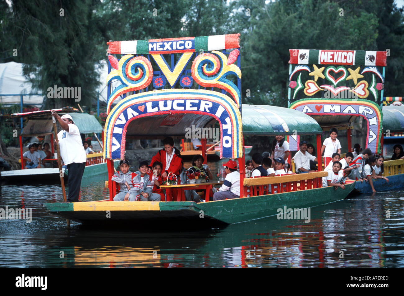 Mexico City, UNESCO patrimony site Xochimilco and trinjeras which tourists hire to be poled in the canals - Stock Image