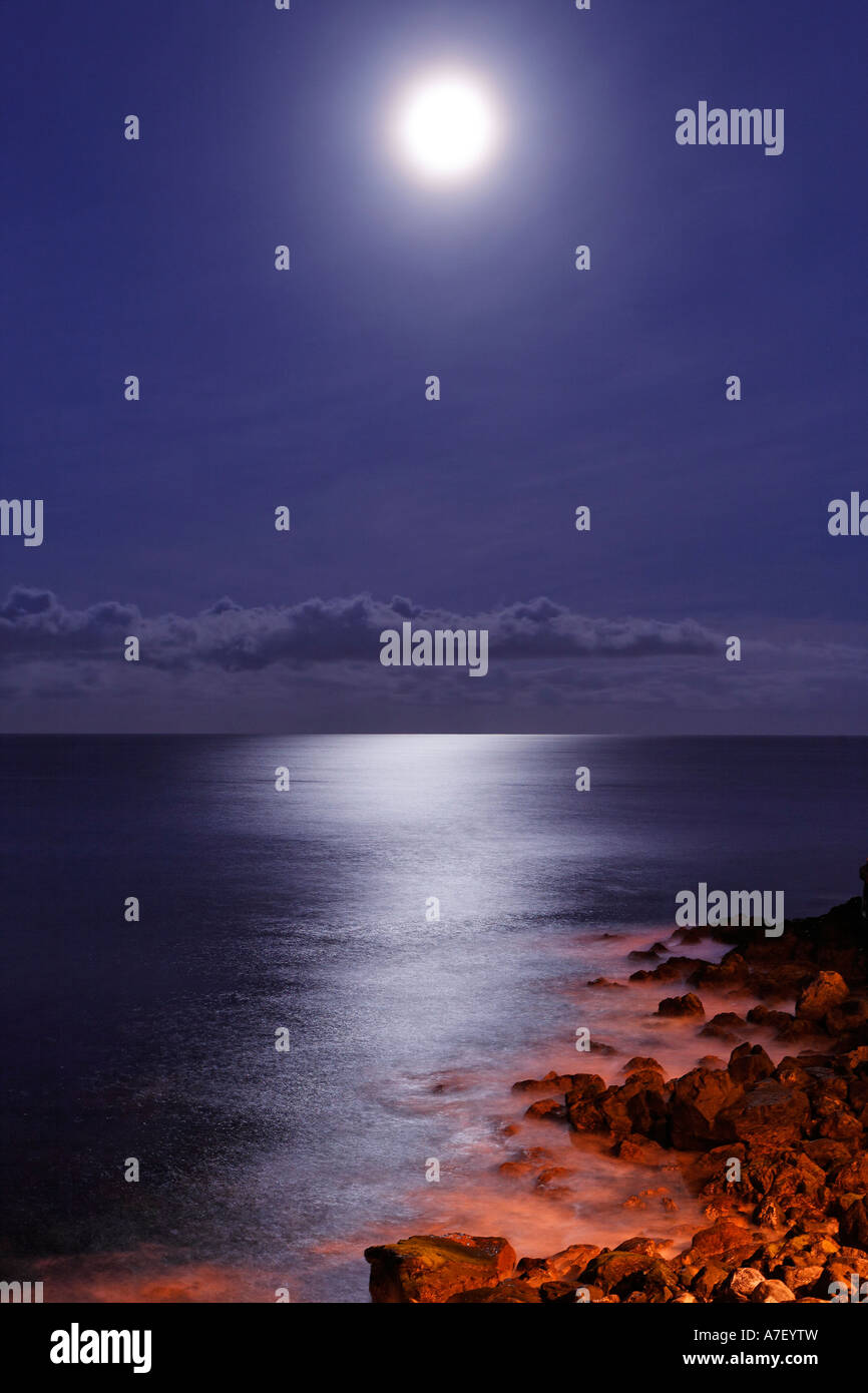 Sea and the rocky coast in the moonshine, Camara de Lobos, Madeira, Portugal - Stock Image