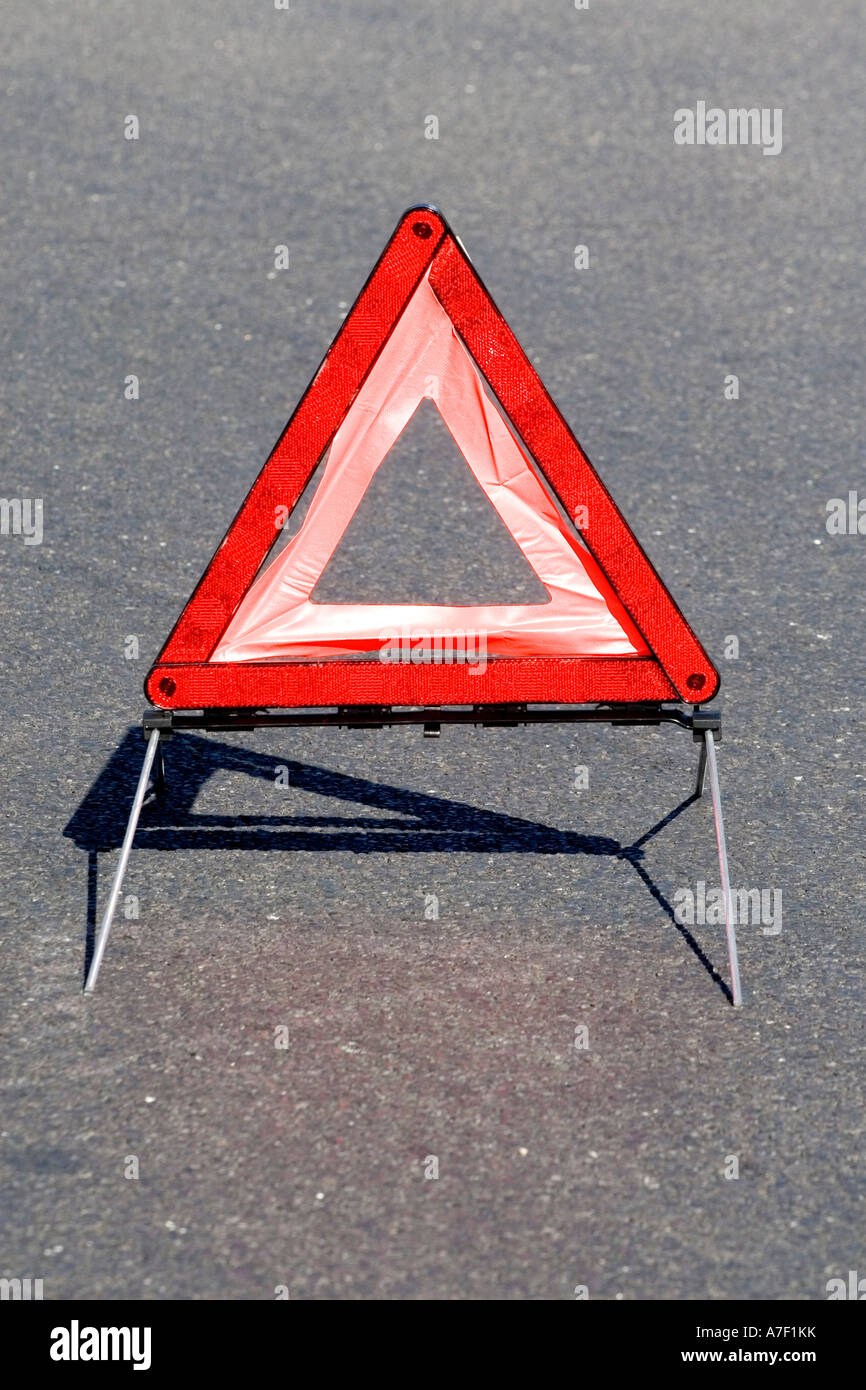 Warning triangle on a road Stock Photo