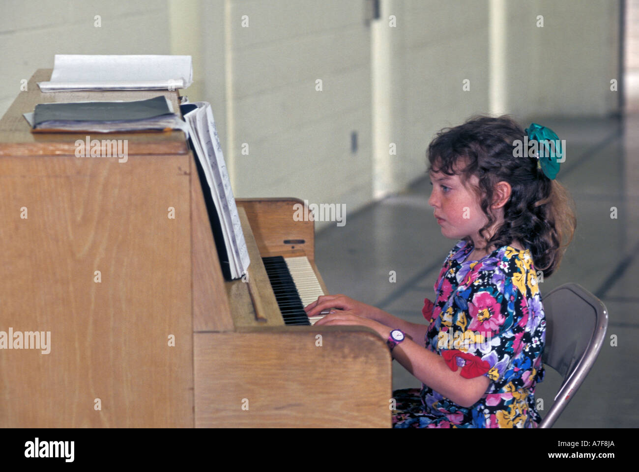 Livonia Michigan Mariel West 9 plays the piano during a recital - Stock Image