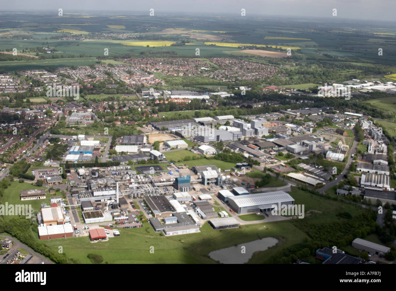 High level oblique aerial view south west of residential buildings industrial estate sports ground cemetry Haverhill - Stock Image