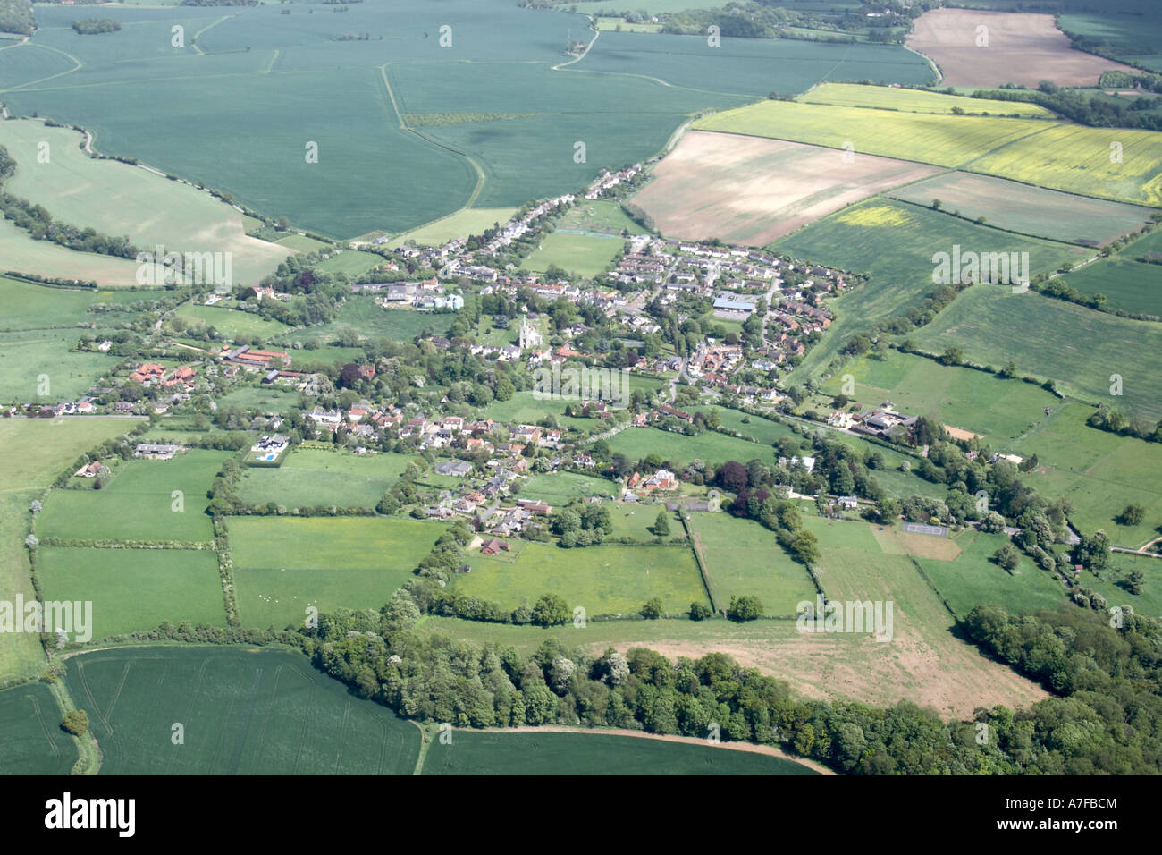 High Level Oblique Aerial View North East Of Rape Fields Small Village Clouds In Essex Near Bishops Stortford