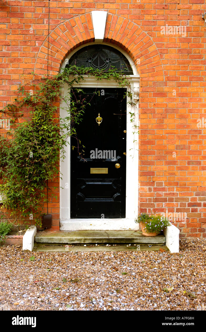 Black Front Door Of A Traditional Georgian Style British House Stock