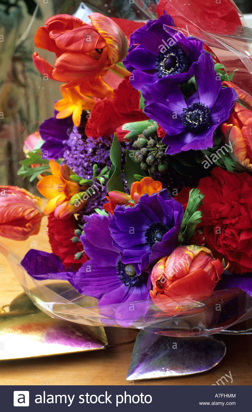 Colourful bouquet of red purple orange flowers including tulips ...
