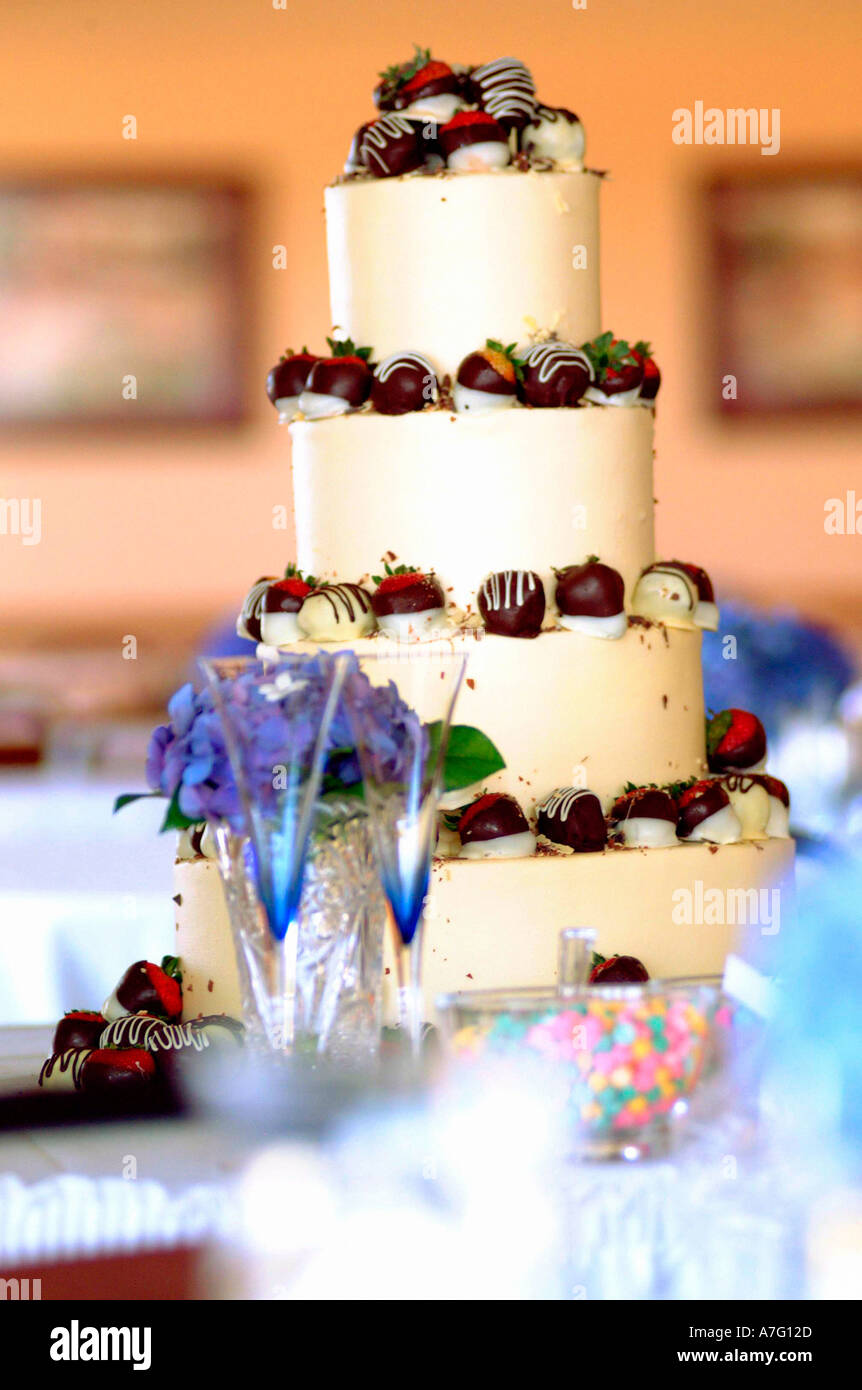 Colorful Wedding Cake With Chocolate Covered Strawberries Stock