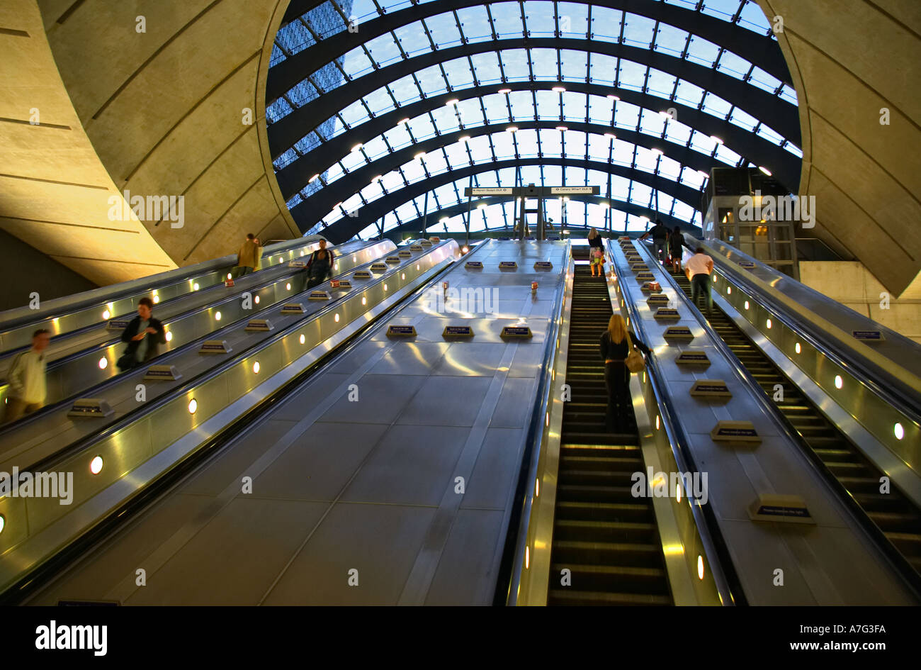 Canary Wharf tube underground station escalators in Docklands London England Britain UK - Stock Image