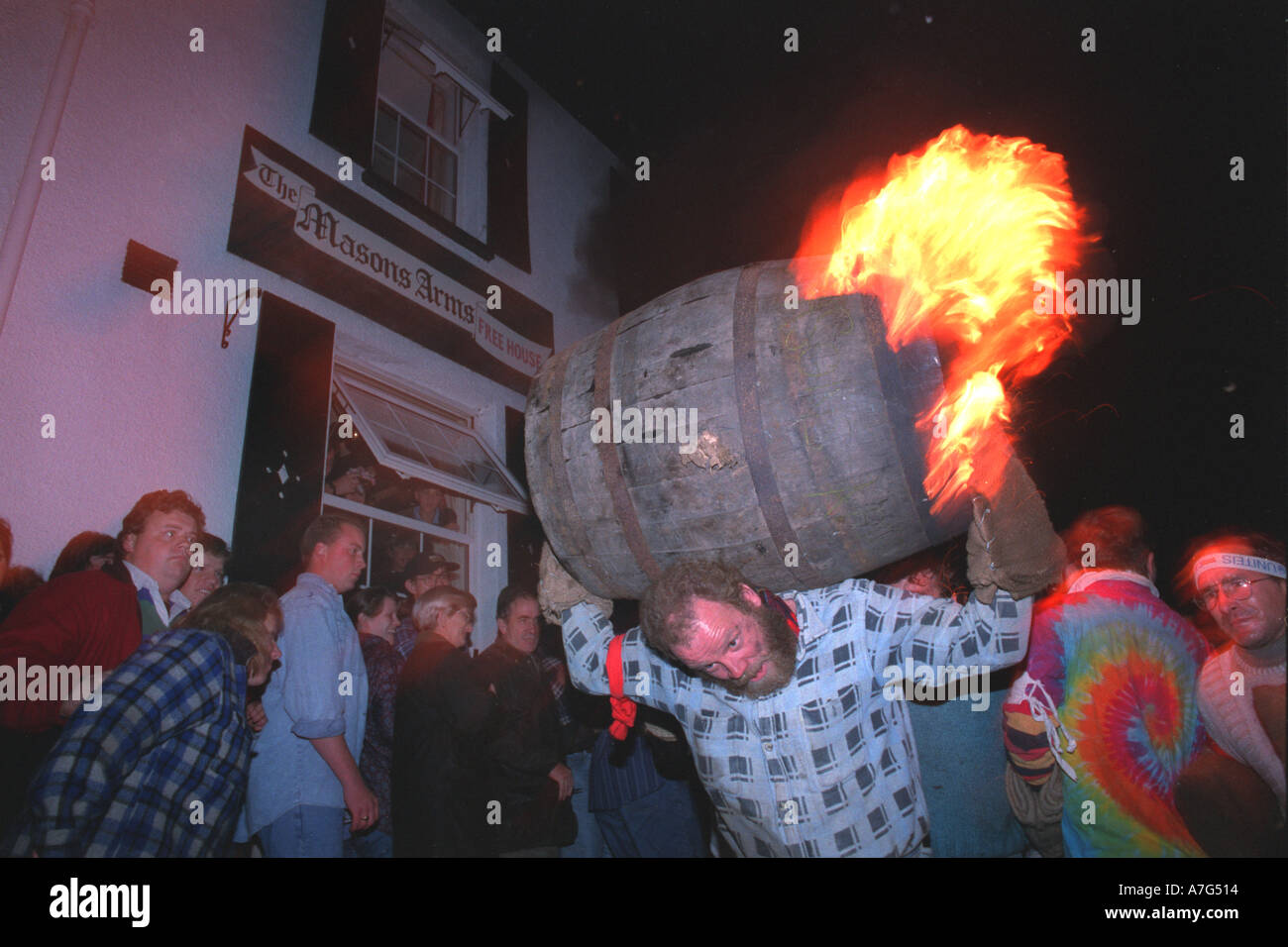 Tar barrel running in Ottery St Mary Devon UK - Stock Image