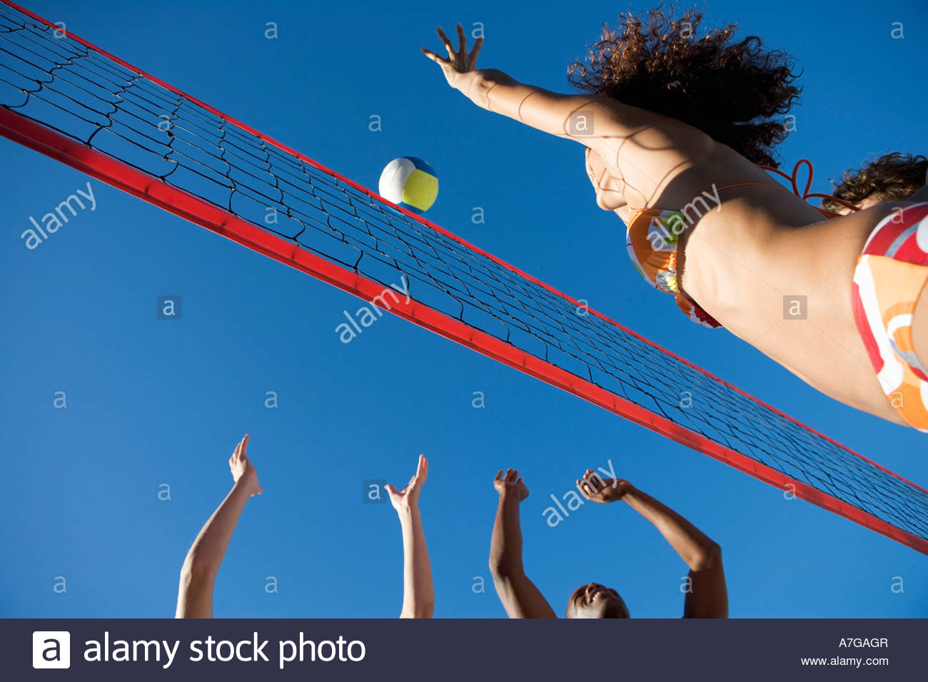 A game of beach volleyball - Stock Image