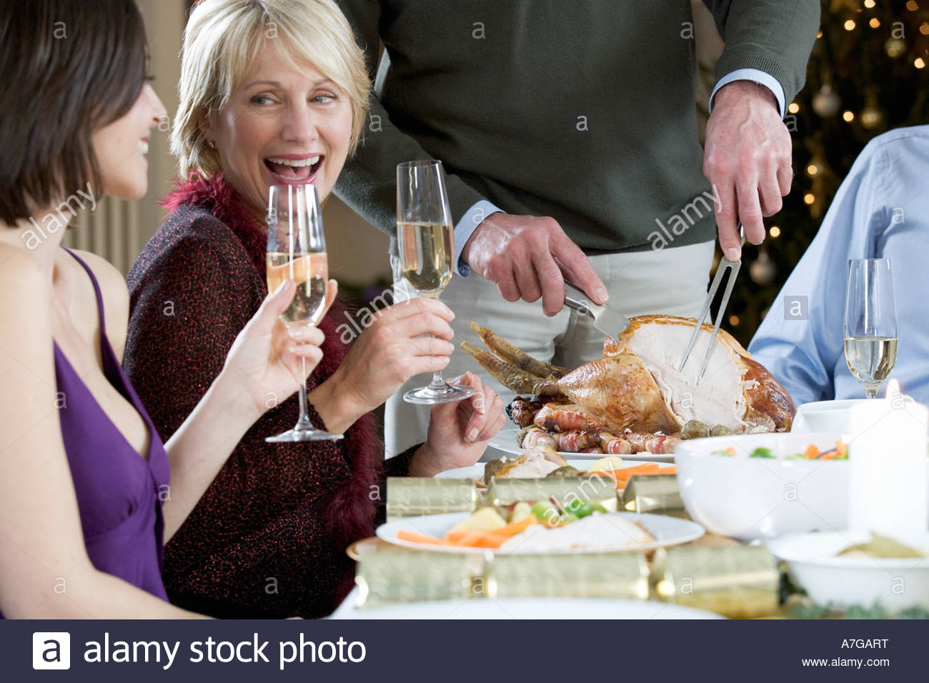 A family sitting down for Christmas dinner - Stock Image