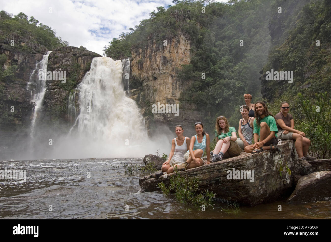 A group of european female tourists and guide at the 120 meter waterfall in The Chapada dos Veadeiros National Park - Stock Image