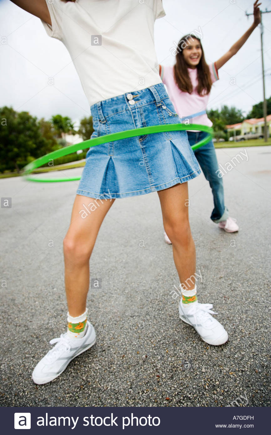 Two young girls with hoops Stock Photo