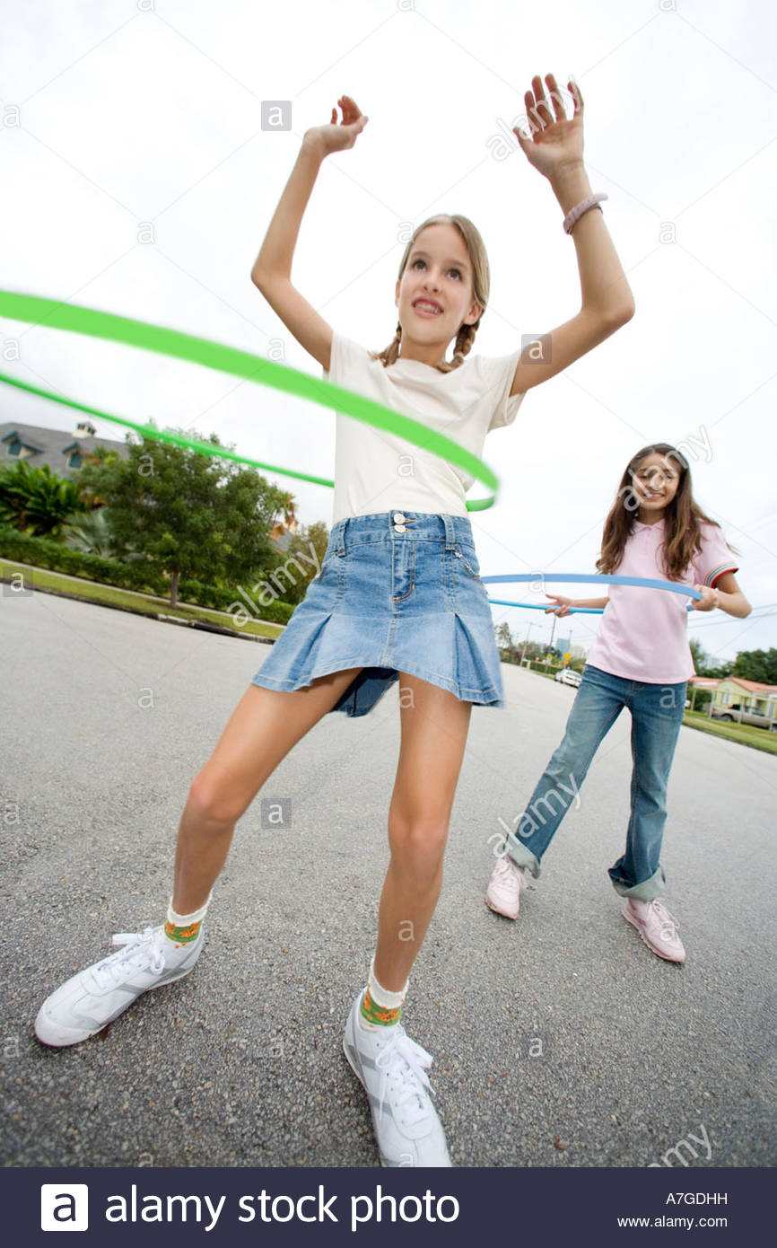 Two young girls with hoops - Stock Image
