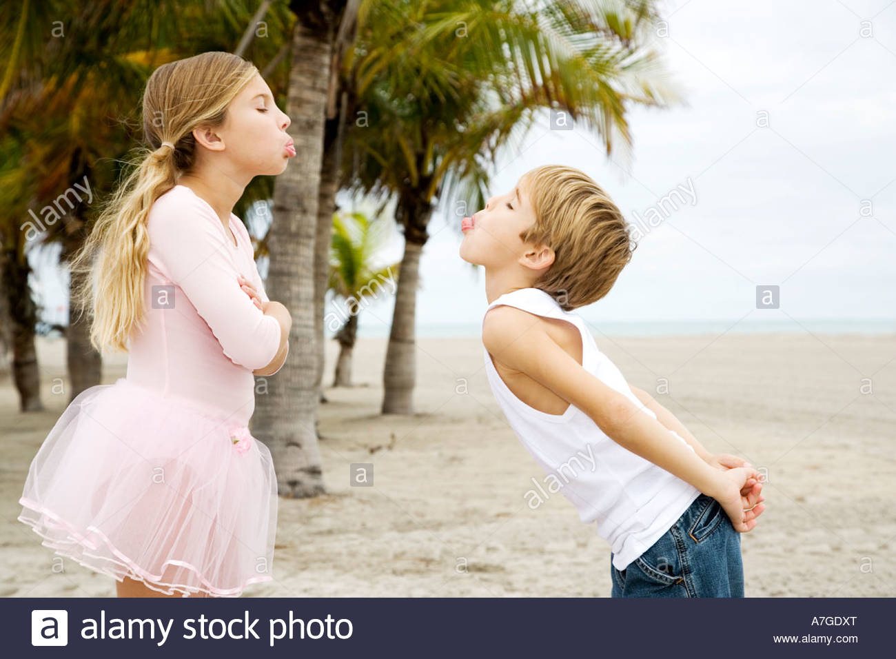 Two children on a beach - Stock Image