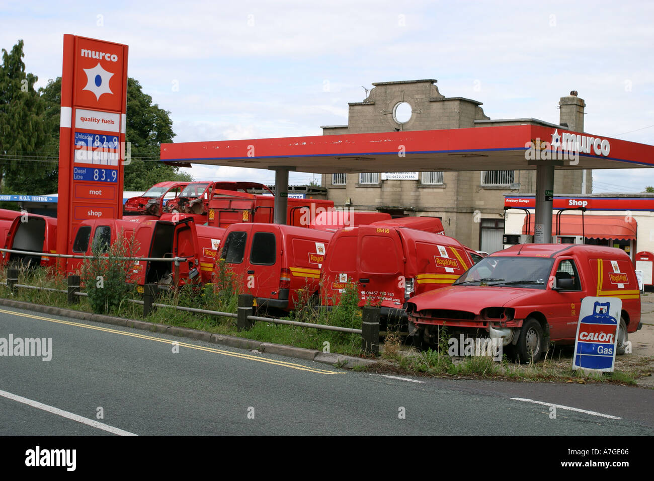 Accident damaged Royal Mail and Post Office vans on a garage Stock