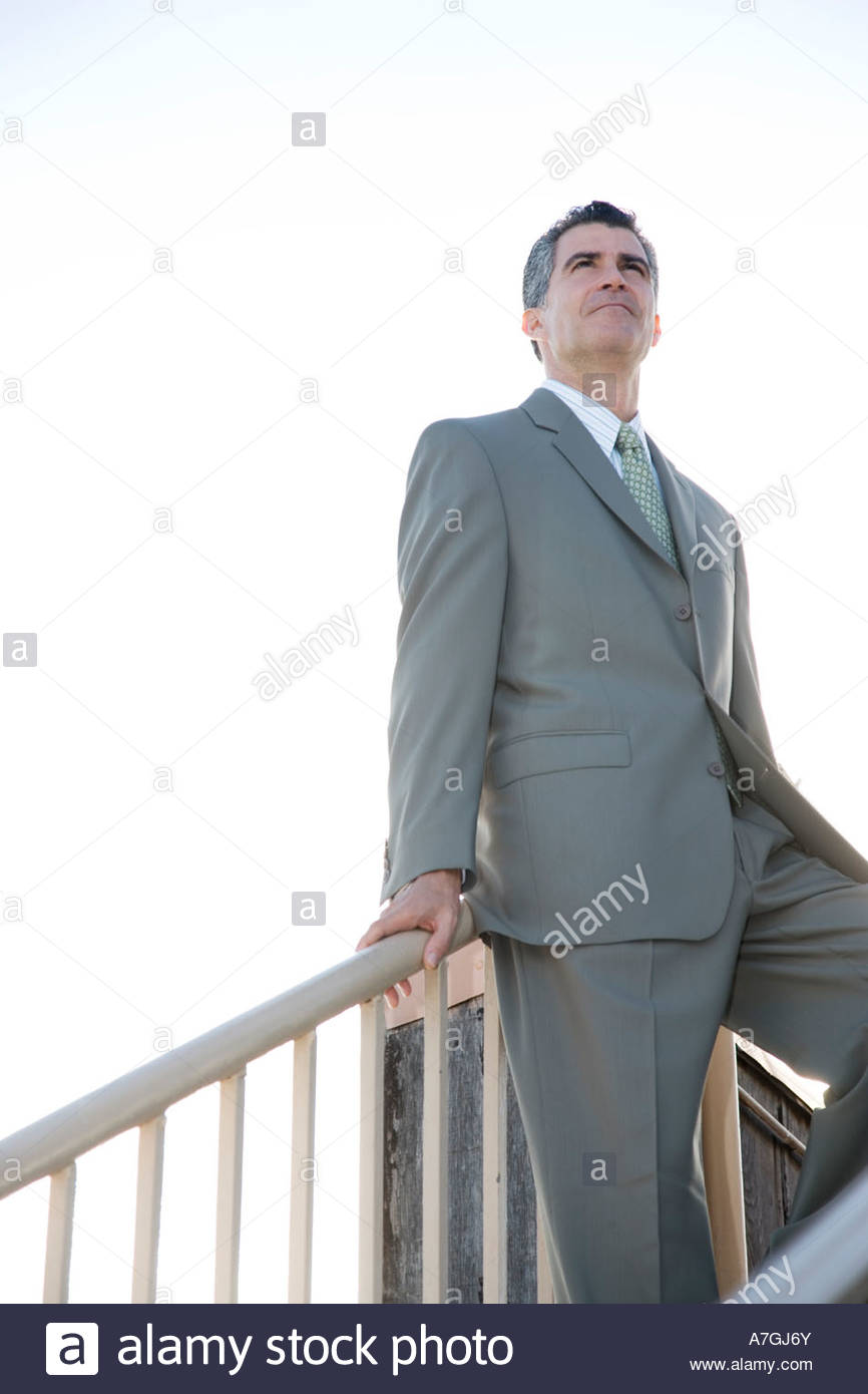 A businessman standing on the top of a flight of steps Stock Photo