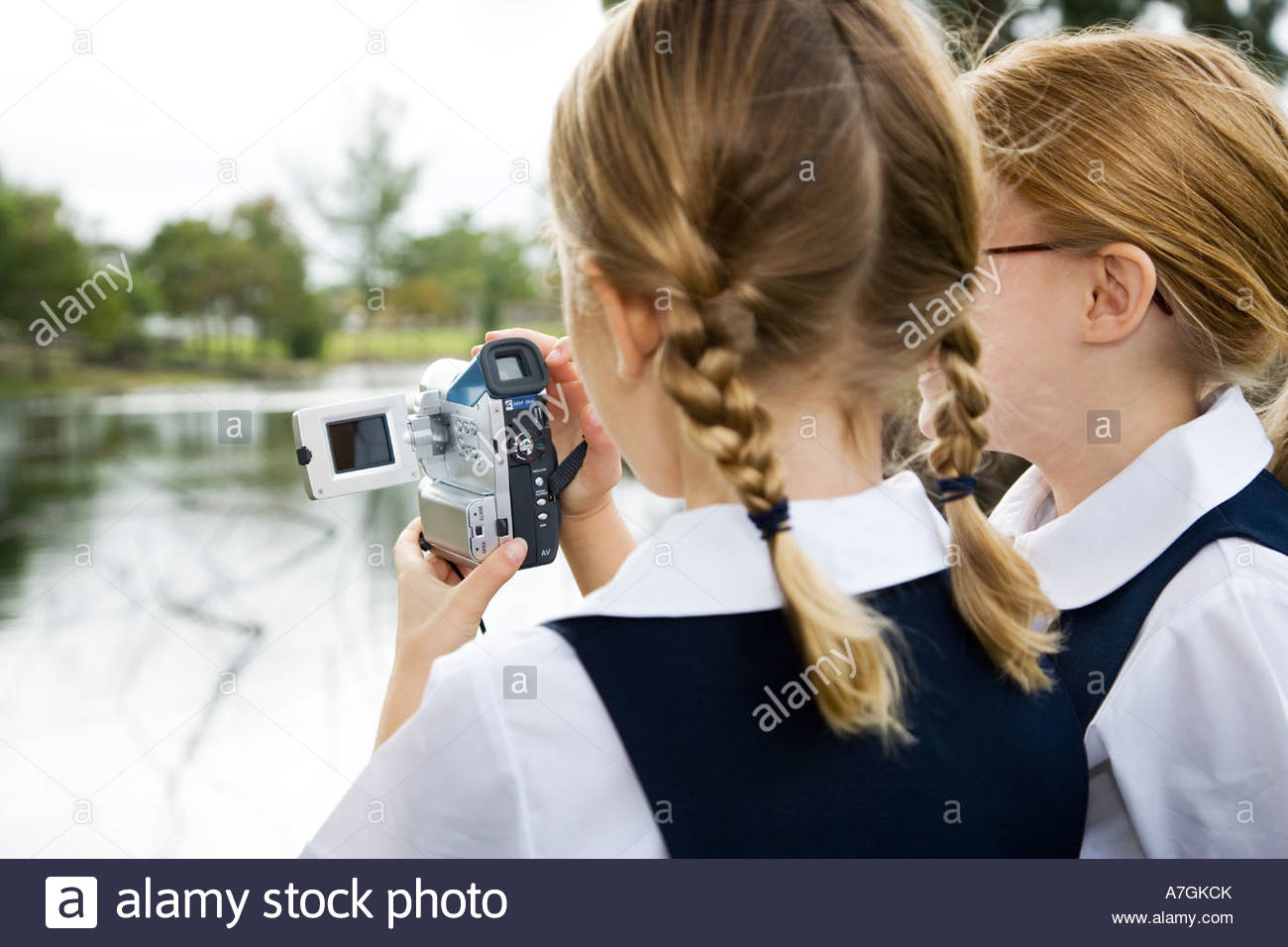 Two schoolgirls using a video camera - Stock Image