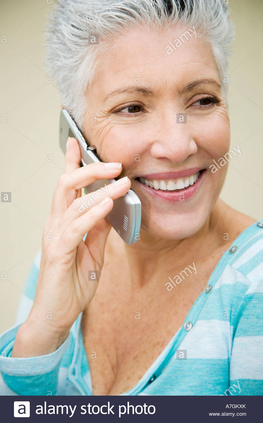A senior woman using a mobile phone - Stock Image