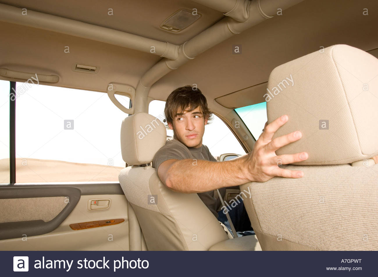 A young man in a car - Stock Image