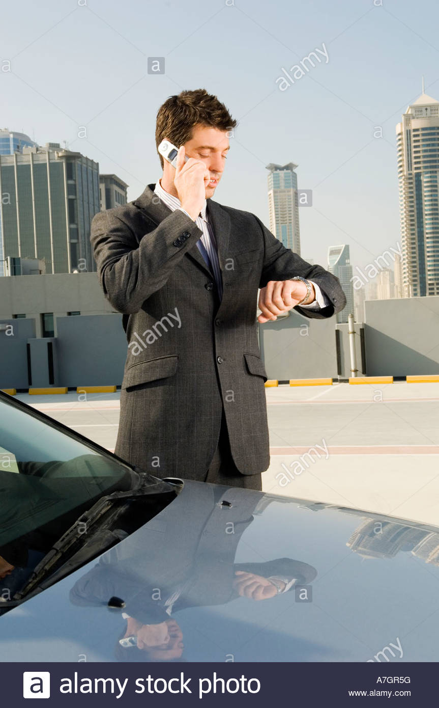 A businessman talking on a mobile phone - Stock Image