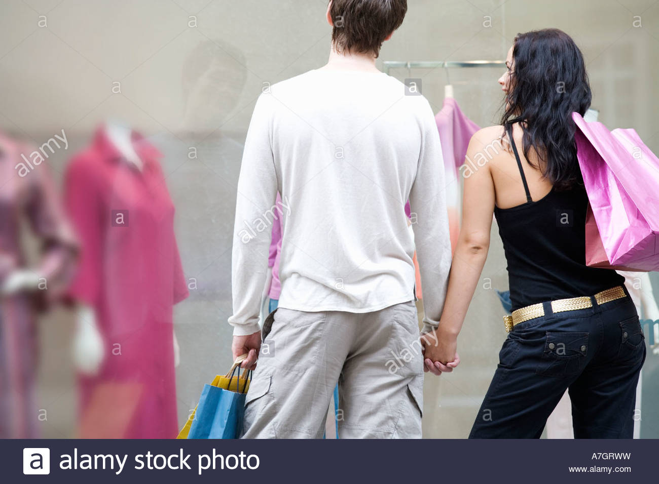 A young couple out shopping - Stock Image