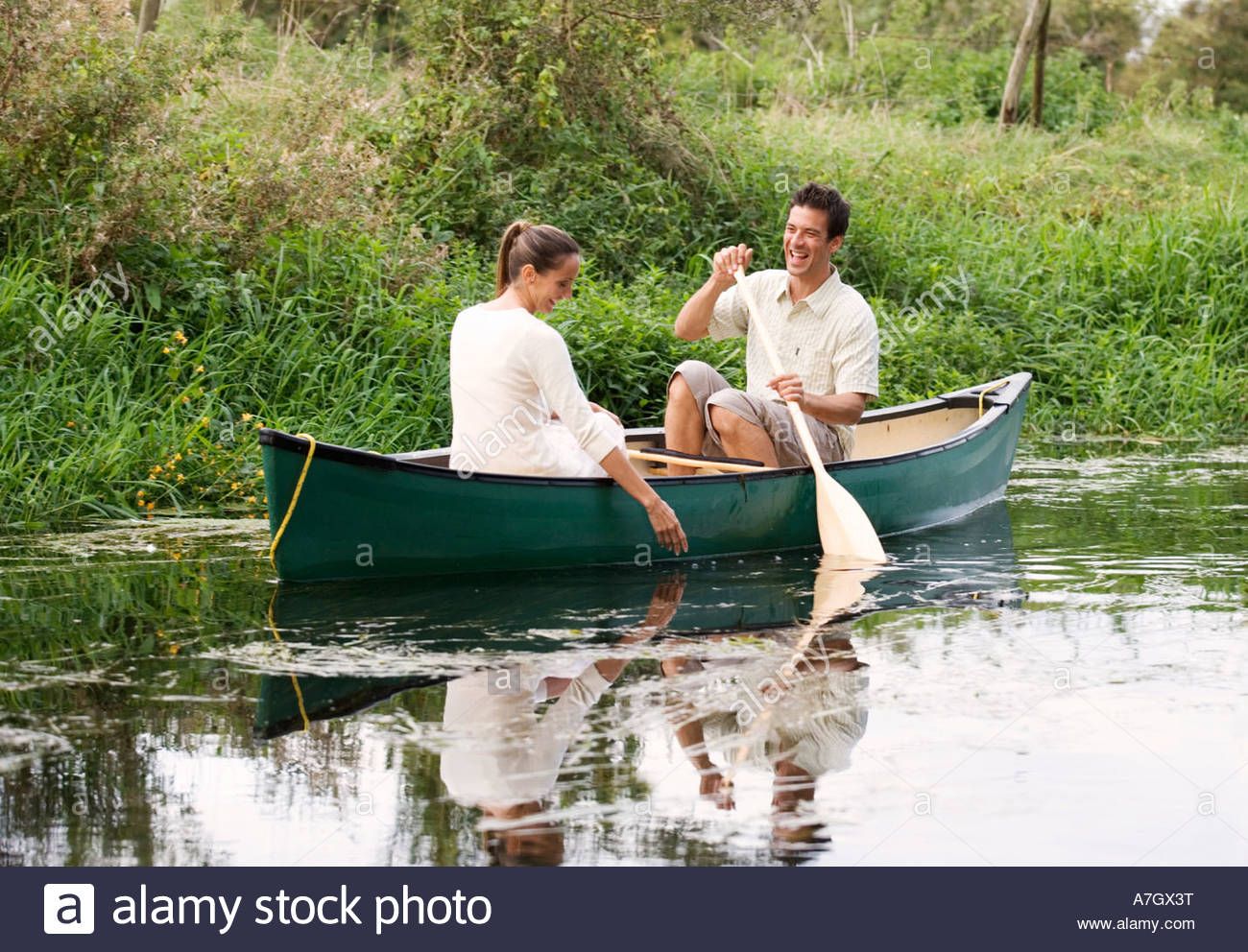Young couple in a rowing boat - Stock Image