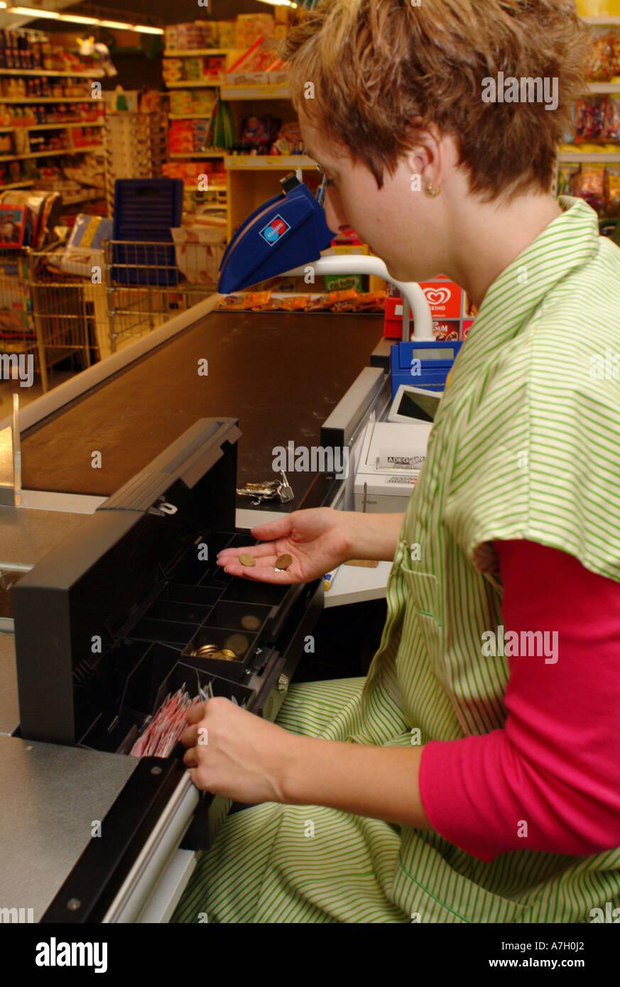 cashier in supermarket - Stock Image