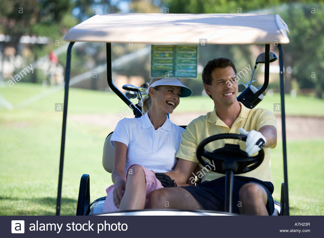 Couple in a golf buggy - Stock Image