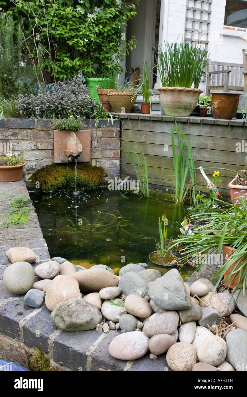 Small raised garden pond with brick walls and fountain ... on above ground garden ponds ideas, diy small water feature ideas, raised garden pool ideas, raised pond kit, raised flower bed with pond, raised pond preformed, raised bed garden with pond, brick wall outdoor fountain ideas, raised turtle pond, raised koi pond, raised garden pond plans, raised garden for small ponds,