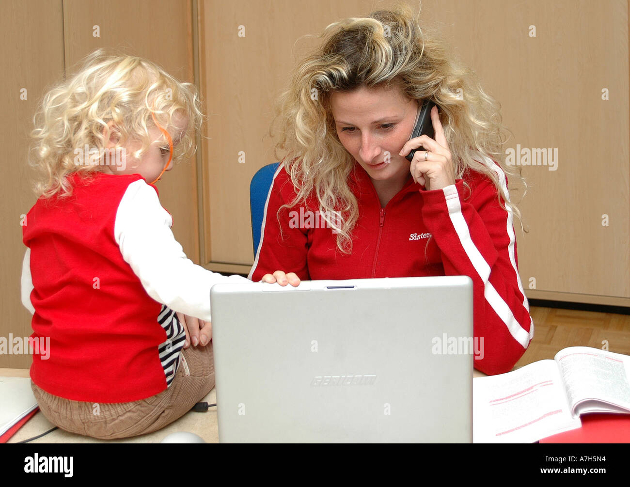 mother with child in office Stock Photo