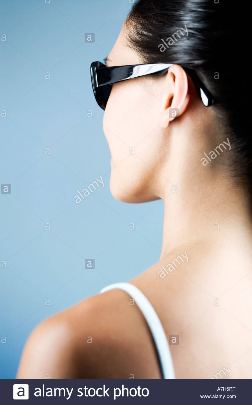 A young woman wearring sunglasses - Stock Image
