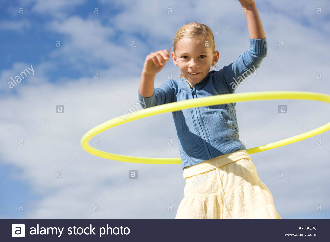 A young girl with a hoop - Stock Image