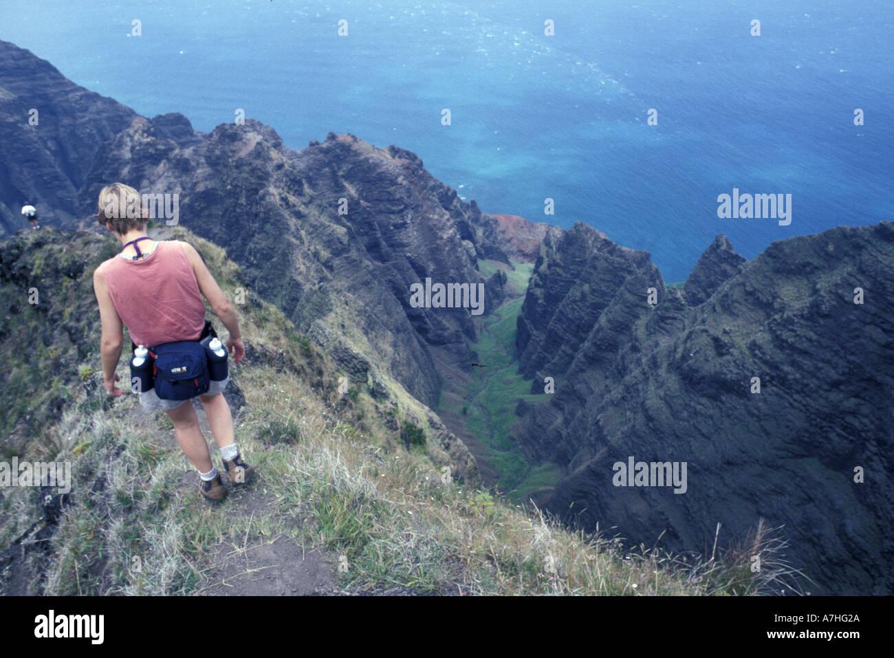 usa, hawaii, kuai, na pali coast, alyson pytte hikes on cliffs above