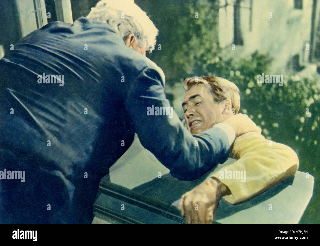 REAR WINDOW 1954 Paramount film with James Stewart at right, directed by Alfred Hitchcock - Stock Image