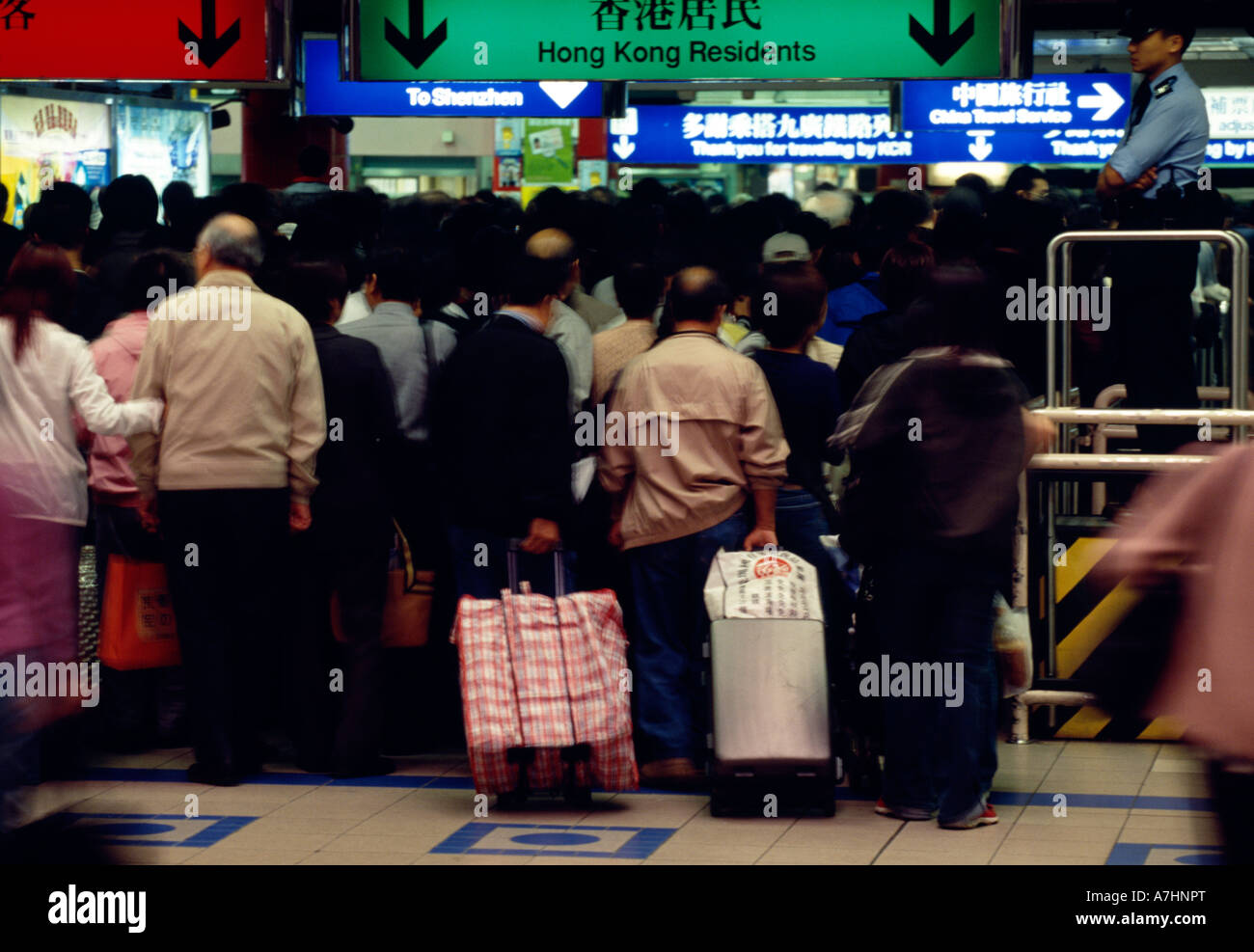 Crowds of people queue at the customs and immigration channels - Stock Image