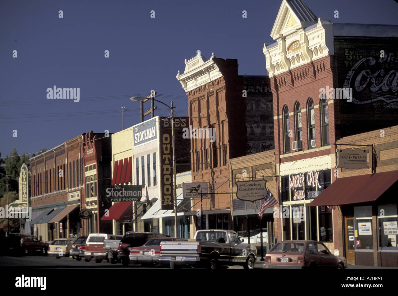 NA, USA, Montana, Livingston Western storefronts on Main Street; cowboy town; sunset - Stock Image
